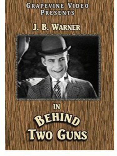 Behind Two Guns