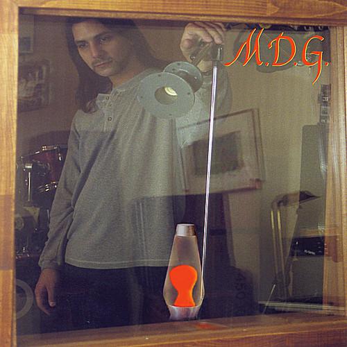 M.D.G.