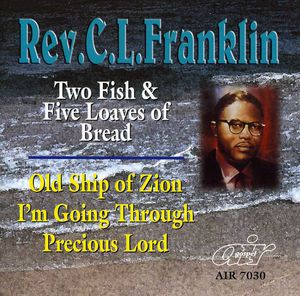Two Fish and Five Loaves Of Bread